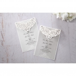 Two rectangular laser cut invite with elaborate jewel embellished laser cut sleeve