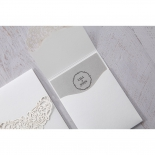 grey and white traditional wedding invitation adorned with jewel