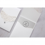 Wedding logo personalised on grey card inserted in a white laser cut pocket