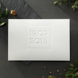 Trifold textured card with embossed date in the center