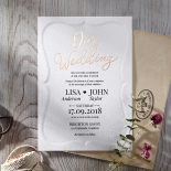 Gold foiled invite with embossed border.