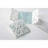 Invitations with white laser cut flower sleeves and soft blue insert