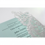 Cropped gated wedding invitation with white floral themes