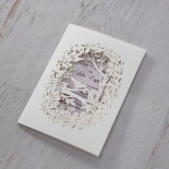 Wedding card with lilac insert and bird themed white laser cut sleeve