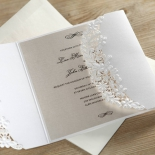 Unfolded three panelled invite sleeve with raised inked card