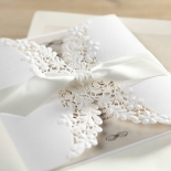 Cream and white floral card featuring white satin sash