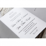 White folded canvas card with classic black and white text