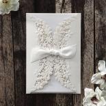 All white matte floral designed bridal stationery