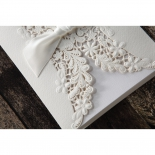 Embossed and laser cut flowers on all white textured card stock