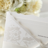 Silk screened pocket with floral design and ribbon