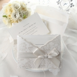Raised ink printed wedding card with silk screened pocket and flowers