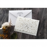 Ivory floral wedding invite with white envelope