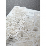 Pearlised paper attached to a matte laser cut pocket designed with flowers