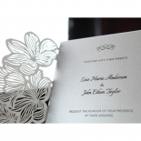 Silver and white pocket invitation with flower designs