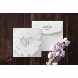 Envelope with folding white wedding invitation designed with hearts