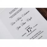 White textured wedding card design with gold details