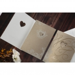 Gold threefold bridal invitation with heart cut out on the cover