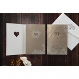 Shimmer covered gold invitation with heart laser cut out