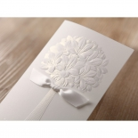 Traditional folded invitation designed with ribbon and flowers