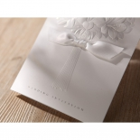 Cropped view of the bouquet embossed invite with foil text