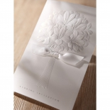 Traditional wedding invitation showcasing a bouquet design embossed