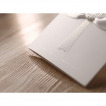 Ribbon designed floral card with embossed bouquet