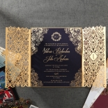 Sophisticated black card in gold foiled border with intricate laser cut pocket