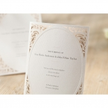 Folded vintage wedding invite with canvas texture and foiling