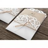 Brown invitation insider inside a burlap ribbon designed matt pocket
