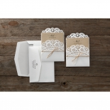 Two envelopes and two rustic themed lace designed invites