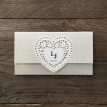 Creamy beige invite with a charming heart laser cut center
