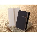 Formal invitation in folded navy pocket with envelope