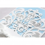 Lace patterned white invitation sleeve with blue inner layer