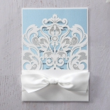 Blue and white themed classical invitation with lace designs and a bow