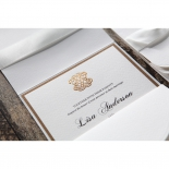 Embossed gold emblem on top of the textured white vintage card