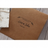 Wedding invitation text on the front fold of the brown paper