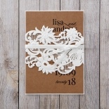 White floral lace laser cut sleeve with brown craft paper tied with a satin bow