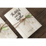 Forest themed wedding card featuring accent leaf and bow