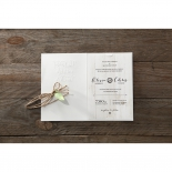 Wooden theme wedding invite card attached in the forest inspired sleeve