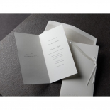 White wedding cards unfolded revealing classic text and thermography print