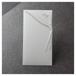 Embossed printed pocket of classic white invitation