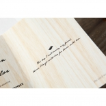 Three fold brown wood designed invite card with classic black text