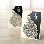 White peacock laser cut invite sleeve with digitally printed invite