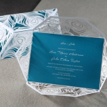 Aqua themed invite card with peacock inspired elements