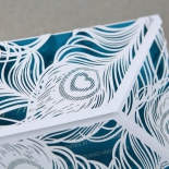 Modern feather themed white sleeve with flat card insert