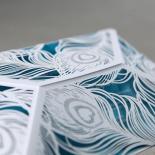 Feather designed white non glossy sleeve with invitation in aqua