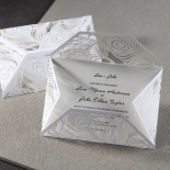 Two similar wedding cards, opened and unopened, feather themed wraps