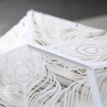 Contemporary white peacock wrap laser cut and white insert