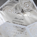 Unfolded laser cut wrap with white inner and feather designed flaps