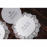 Laser cut lace designed round white invitation unfolded